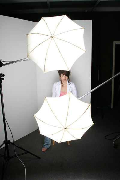 Briana in the light of two umbrellas for a clamshell approach.