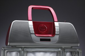 This shiny, colorful iPod boom-box presents several challenges to the product photographer.