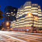architecture photography: InterActiveCorp's headquarters (IAC building) at the blue hour and designed by architect Frank Gehry located at 550 West 18th Street on the corner of Eleventh Avenue in the Chelsea neighborhood of Manhattan, New York City, NYC