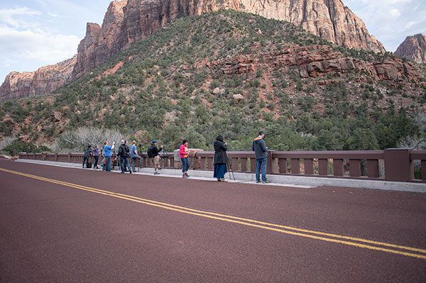 Photographers gathering on the bridge over the Virgin River at the mouth of Zion Canyon. Some times of the year find this bridge nearly impassable for the tripods and photographers!